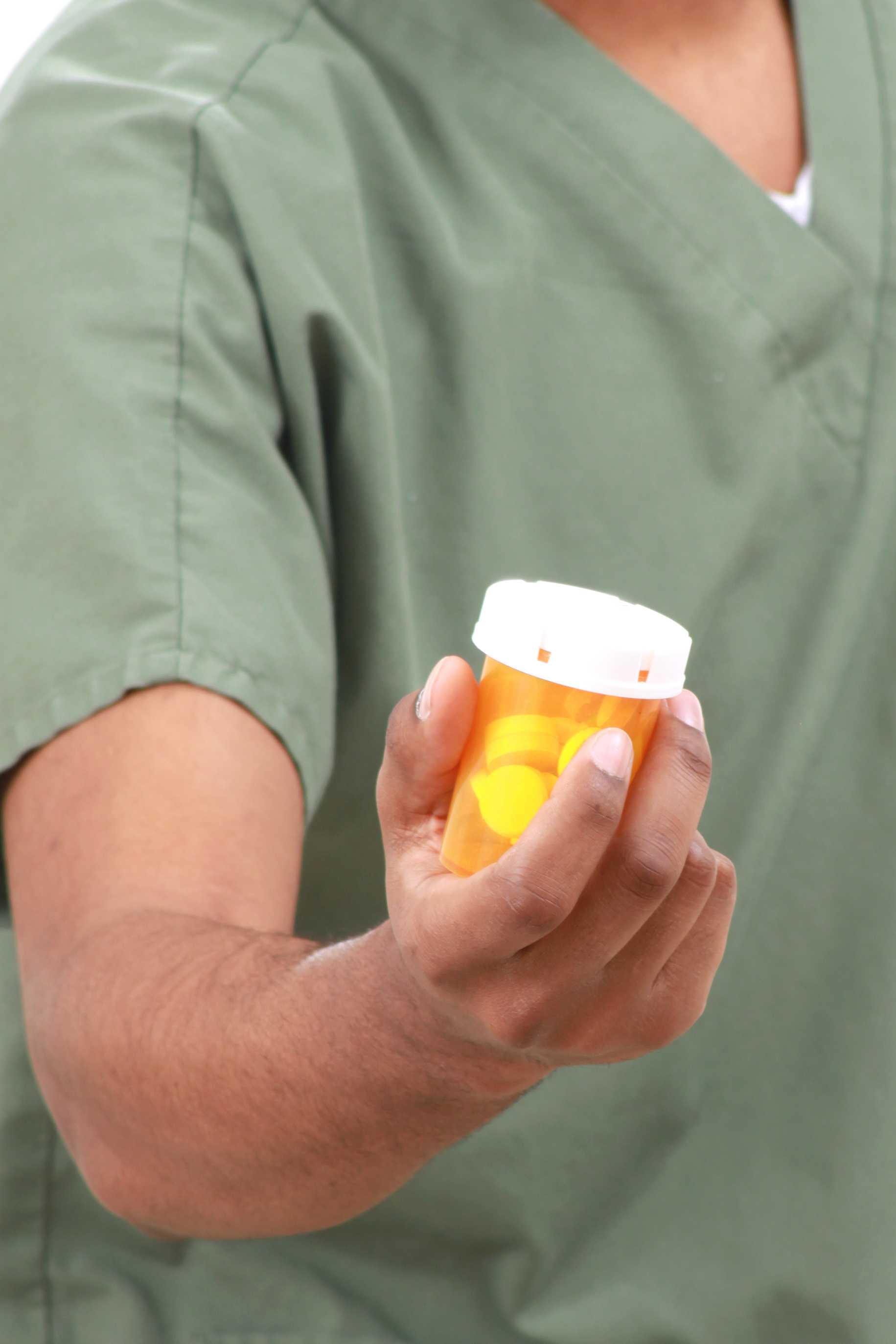 Nurse with medicine bottle in hand