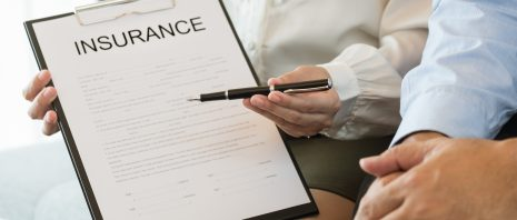 an insurance agent presents insurance documents