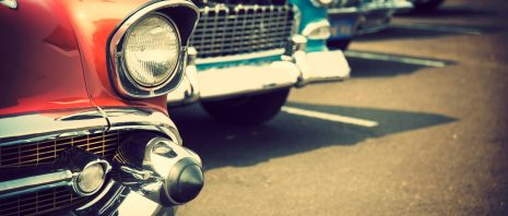 Old classic cars in a parking lot
