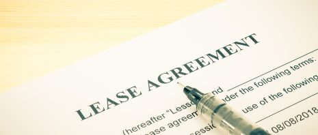 Lease agreement contract sheet and brown pen