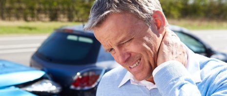 A man experiencing a whiplash injury