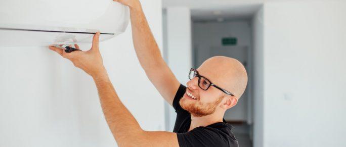 Man installing an AC unit