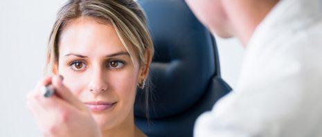 Doctor checks a woman's eye