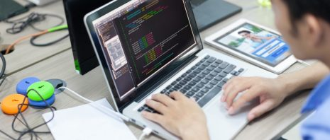 a man looking at codes