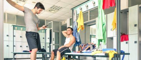 Two men at gym locker room