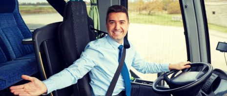 Bus driver welcoming passengers