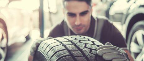 a man examining a tire