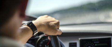 Man's Hand on Steering Wheel