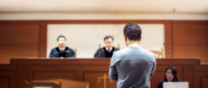 court room case with two judges and a stenographer