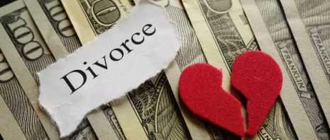 divorce concept with money and a broken heart