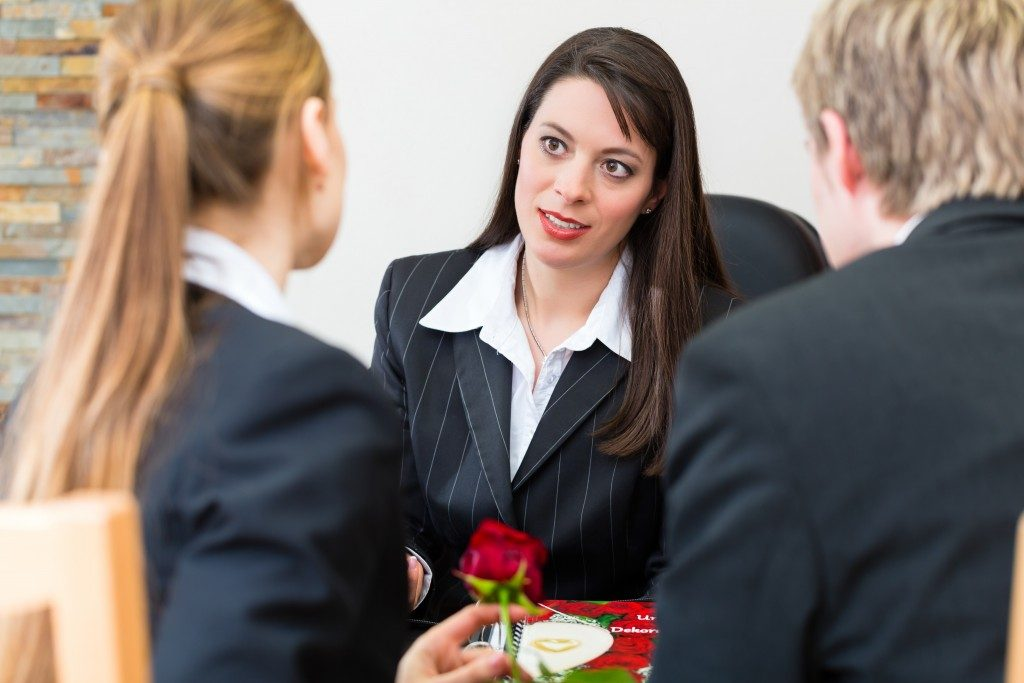Insurance Agent with her clients