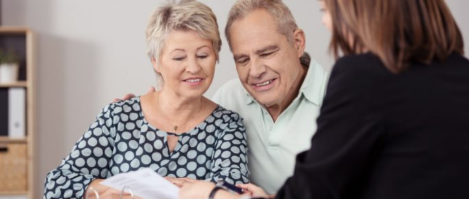 Couple talking to an estate planning attorney