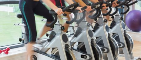 Fitness enthusiasts in a spin class