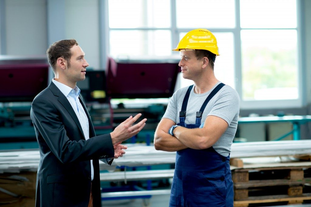 Business owner talking to worker