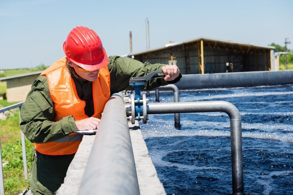 man working in water treatment facility