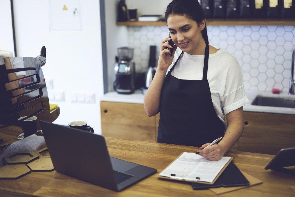 skilled entrepreneur dressed in black apron