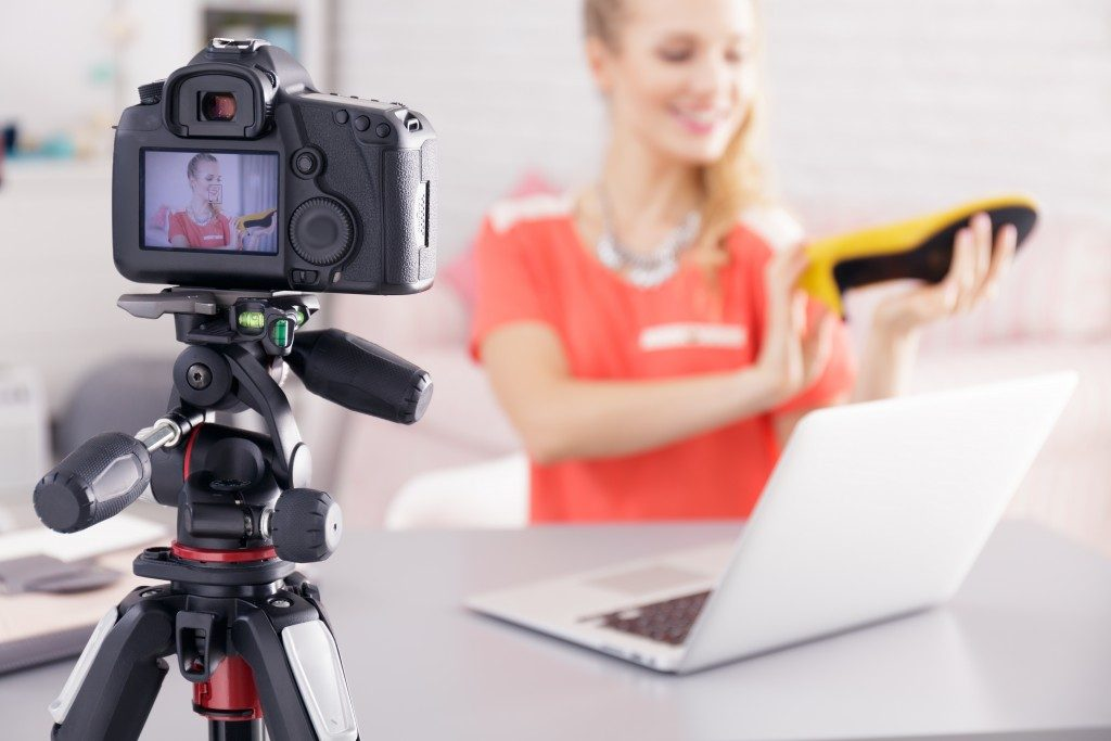 woman doing video blog of her product