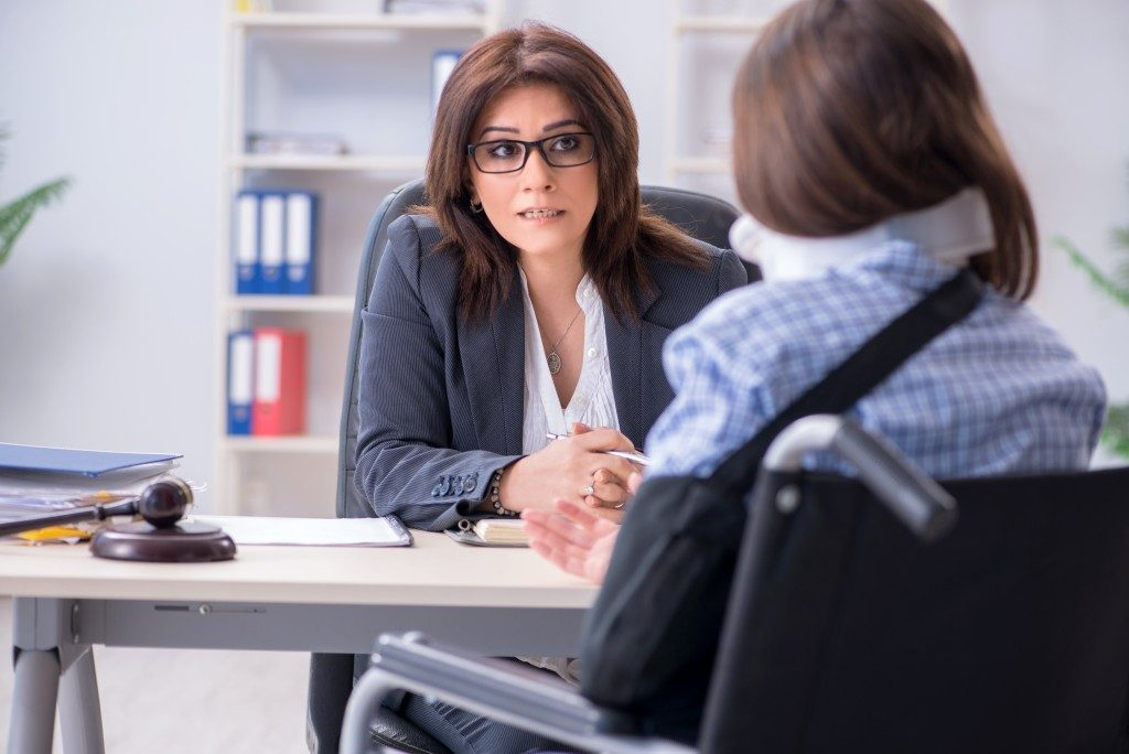 Injured woman consulting a lawyer
