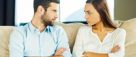 Couple looking at each other angrily