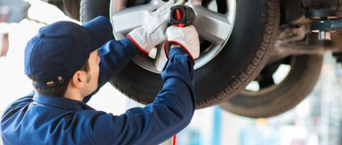 man fixing tires at an auto repair shop