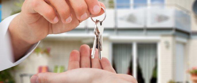 real estate agent handing keys to owner