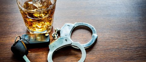 Alcoholic drink and car key DUI concepts