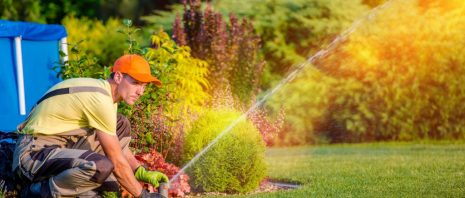 Man testing sprinkler system