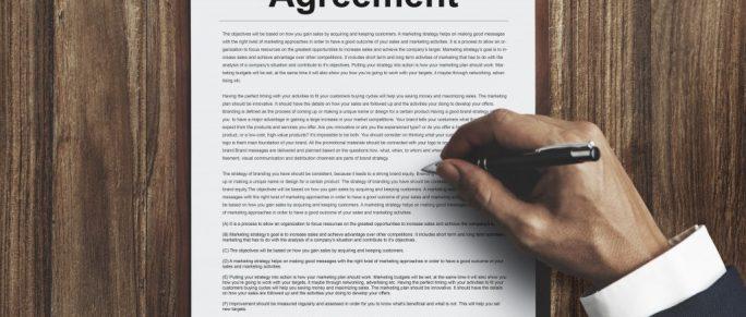 a man signing a divorce agreement