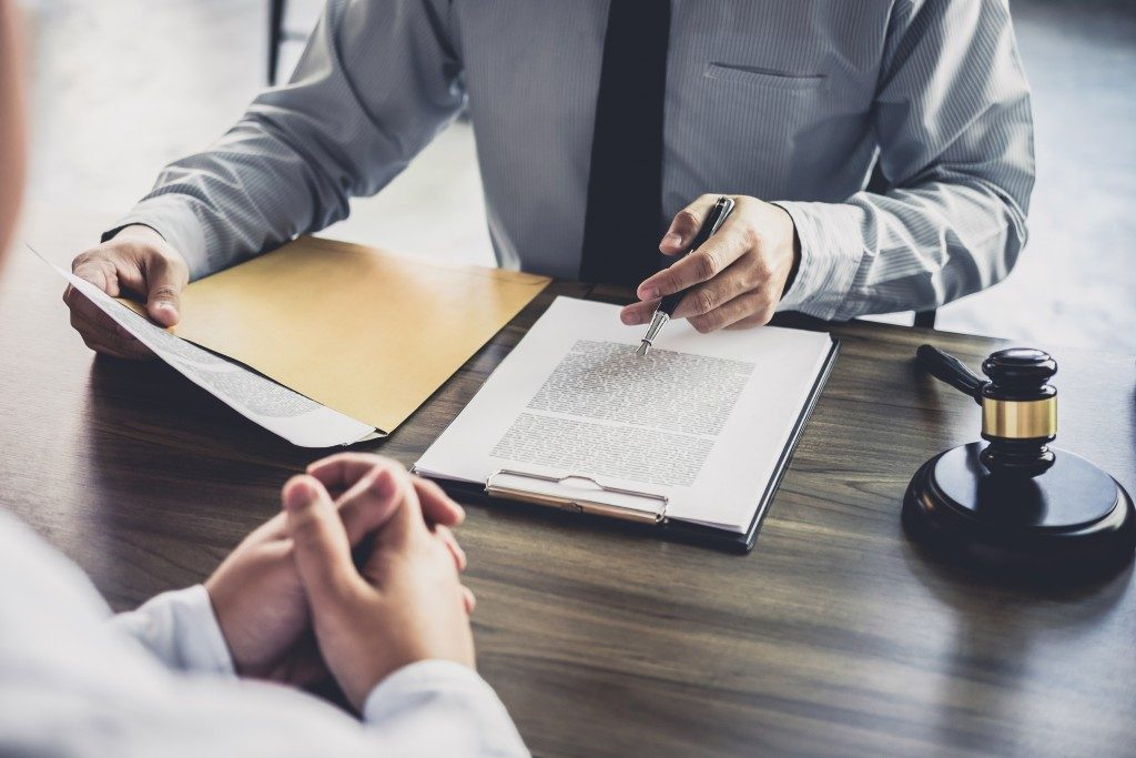 discussing a contract with a lawyer